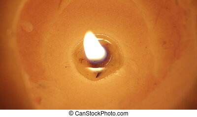 Candle light outdoors. Close-up.