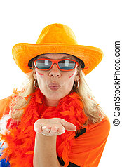 female Dutch soccer supporter gives a hand kiss