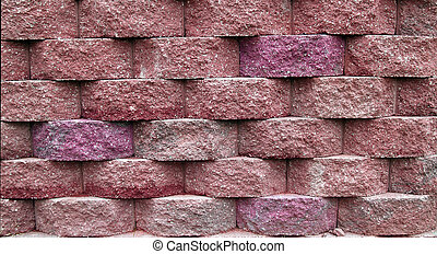 Pink Block Retaining Wall - Blocks on a retaining wall in...