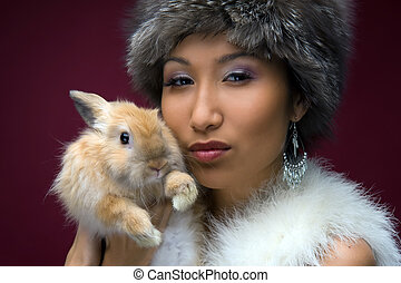 beautiful woman with rabbit - Portrait of the beautiful...
