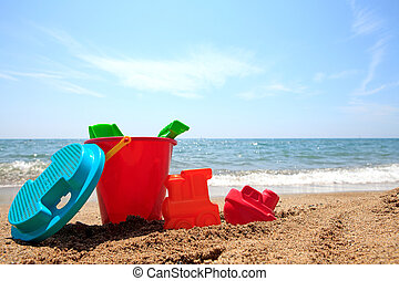 colorful plastic toys at the beach
