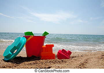 plastic colorful toys at the beach