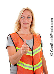 woman in safety vest with thumb up over white background