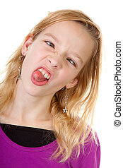 Young girl makes funny face - young girl makes funny face in...