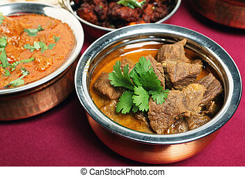 Beef korma curry in bowl - A bowl full of north Indian-style...