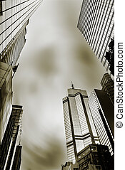 Dramatic cityscape of skyscrapers under sky in Hong Kong,...