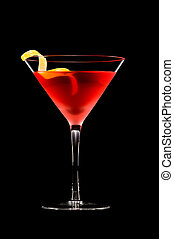 Cosmopolitan cocktail in front of a black background