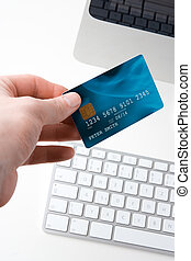 Electronic payment concept - Hand with credit card and...