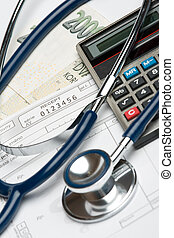 Health financing concept - Stethoscope, blank prescription,...
