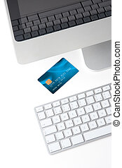 Credit card on white desk with computer - electronic payment...