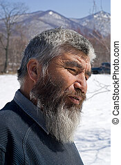 Old Mongoloid Man 13 - A portrait close-up of the old men...