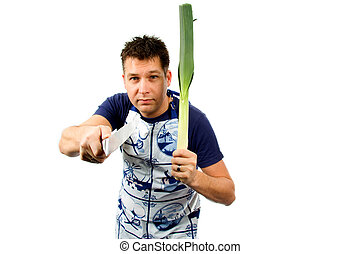 cook is intimidating with leek and knife, isolated on white...