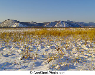 Winter evening in a river Ussuri valley, Russia - Winter...