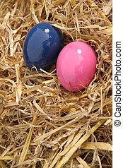 pink and blue eggs on some positioned on some hey, happy...