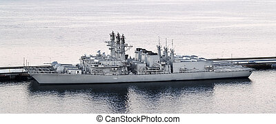 Warship at port - A warship stays at a port waiting for a...