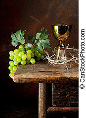 Crown of thorns and wine - Antique wine jug with grapes and...