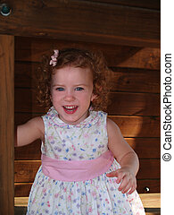 Toddler Laughing in a Tree House - Female toddler laughing...