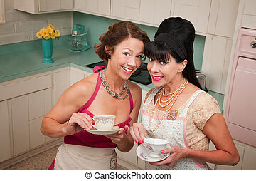 Two Women Gossiping - Two retro housewives with tea in a...