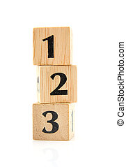 stacked wooden blocks with numbers - Stacked wooden blocks...