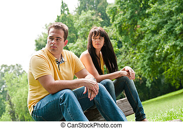 Relationship problems - couple in park