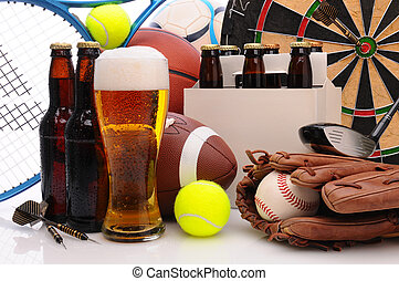 Beer and Sports Equipment - Six pack of beer and frothy...