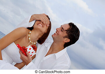 loving couple giving birthday, engagement or wedding gifts.