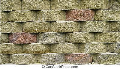 Block Retaining Wall - Multi-colored blocks on a retaining...