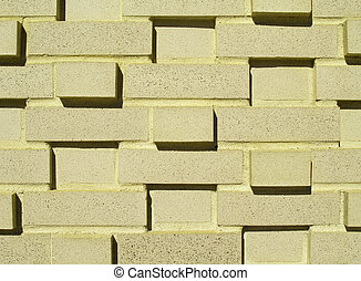 Multi-Layered Yellow Brick Wall - A pastel yellow...