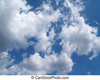 White Puffy Clouds in a Blue Sky - White puffy clouds in a...