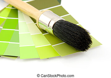 Green color samples and paint brush
