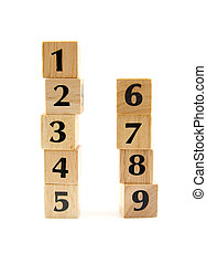 stacked wooden blocks with numbers 1 to 9 isolated on white...