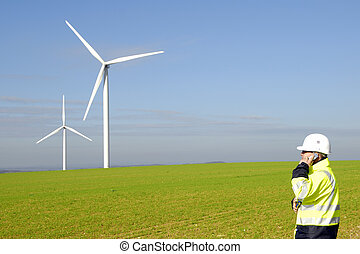 technician and windmills - technician on the phone with...
