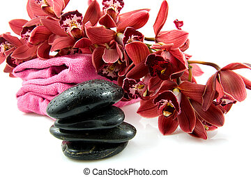 spa stones with red orchid