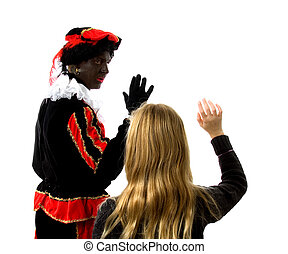 Blonde girl waves goodbye to Zwarte piet ( black pete)...