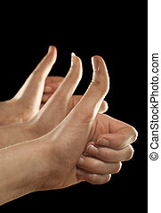 Three hands gesturing fingers up on black background