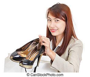 Girl showing fashion shoes