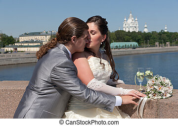 Newly-married couple on the bridge