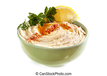 Hummus - Bowl of hummus, with olive oil and paprika,...