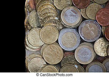Shiny euro coins frozen in ice - Financial concepts - frozen...