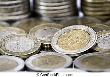 Grungy 2 euro coin with coins on background