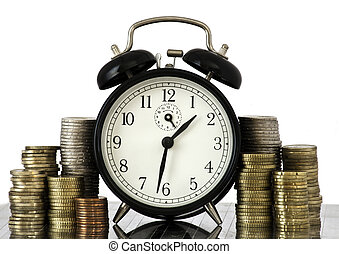 TIME IS MONEY concept: alarm clock and lots of euro coins -...
