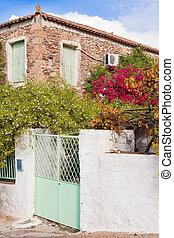 Historic mediterranean home with flower garden - Old greek...