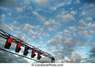 set of red trafic lights - Blue cloudy sky with set of red...