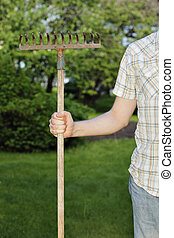 Rake - Man holding a rake in his hand