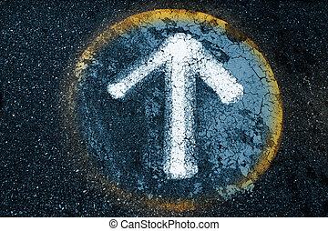 Arrow sign on an old asphalt texture background