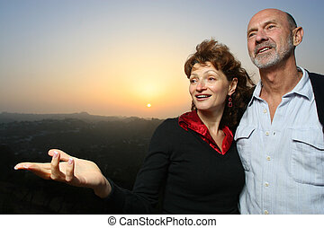 Happy couple outdoors at sunset