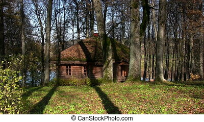 House in  autumn forest - Log cabin in autumnal park