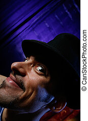 Dramatic portrait of a young man in cylinder hat