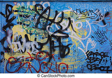 Blue background covered by layers of graffiti