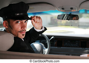 Portrait of a handsome male chauffeur sitting in a car...